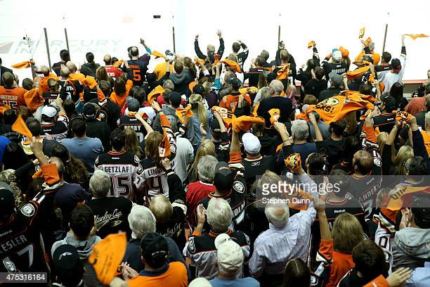Anaheim Ducks fans cheer in Game Seven of the Western Conference Finals during the 2015 NHL Stanley Cup Playoffs at the Honda Center on May 30 2015...