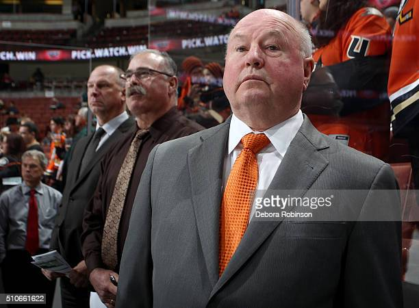 Anaheim Ducks head coach Bruce Boudreau looks on from the bench before the game against the San Jose Sharks on February 2 2016 at Honda Center in...