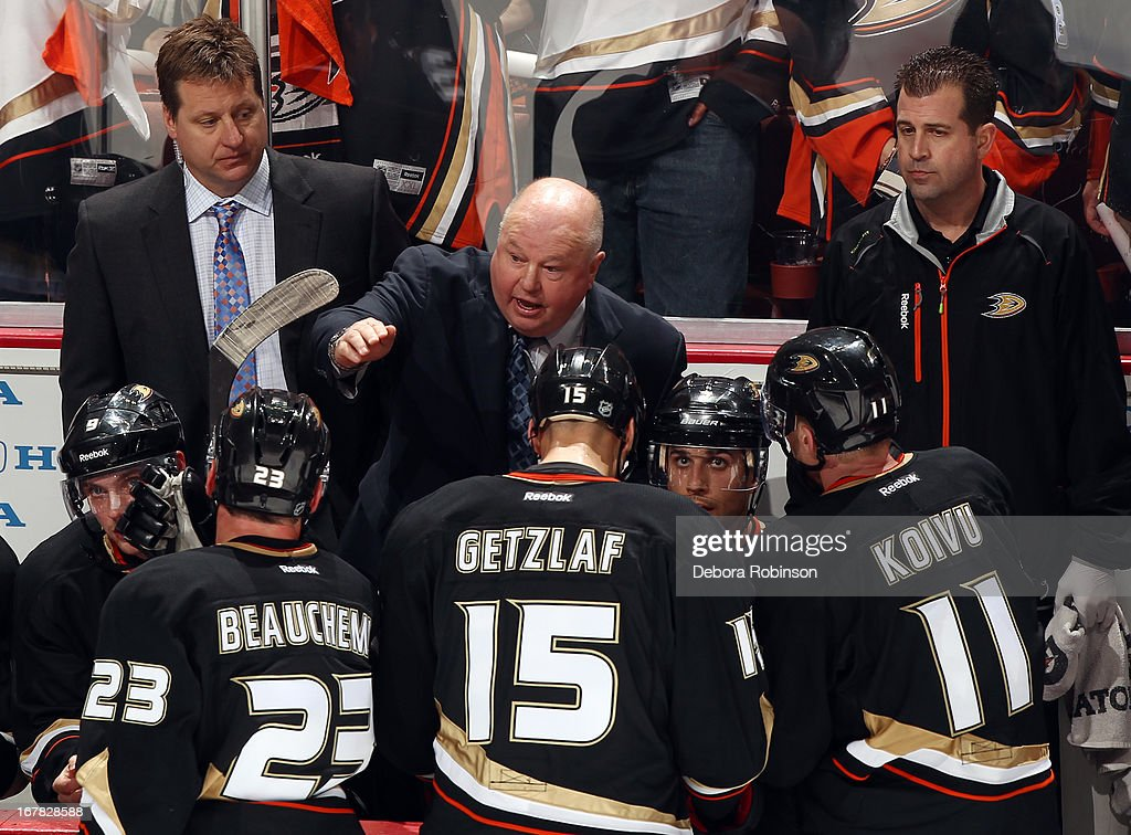 Anaheim Ducks head coach <a gi-track='captionPersonalityLinkClicked' href=/galleries/search?phrase=Bruce+Boudreau&family=editorial&specificpeople=566938 ng-click='$event.stopPropagation()'>Bruce Boudreau</a> talks to his players during the game against the Detroit Red Wings in Game One of the Western Conference Quarterfinals during the 2013 NHL Stanley Cup Playoffs at Honda Center on April 30, 2013 in Anaheim, California.
