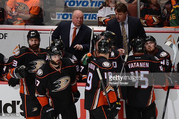 Anaheim Ducks head coach Bruce Boudreau talks to his team during the game against the Chicago Blackhawks in Game Seven of the Western Conference...