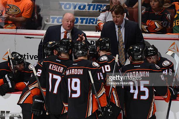 Anaheim Ducks head coach Bruce Boudreau talks with his players during the game against the Chicago Blackhawks in Game Seven of the Western Conference...