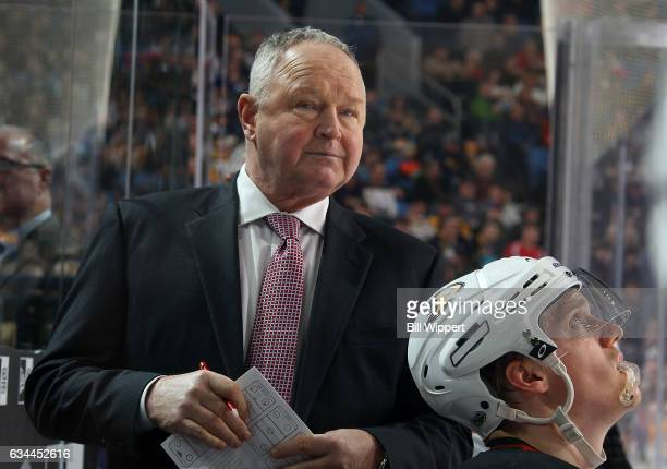 Anaheim Ducks Head Coach Randy Carlyle watches play from behind the bench during an NHL game against the Buffalo Sabres at the KeyBank Center on...