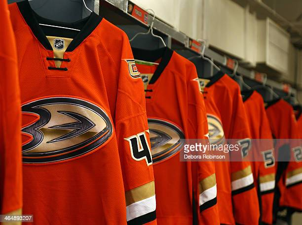 Anaheim Ducks jerseys hang in the locker room prior to team practice in preparation for the 2014 Coors Light NHL Stadium Series against the Los...