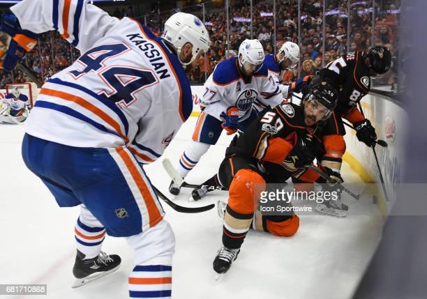 Anaheim Ducks Left Wing Ondrej Kase and Anaheim Ducks Center Antoine Vermette get cornered by Edmonton Oilers Right Wing Zack Kassian Edmonton Oilers...