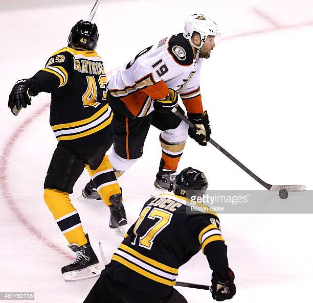 Anaheim Ducks left wing Patrick Maroon walks around Boston Bruins defenseman Matt Bartkowski en route to scoring to put Anaheim up 10 in the second...