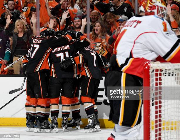 Anaheim Ducks players celebrate a first period goal during the game against the Calgary Flames in Game Two of the Western Conference First Round...