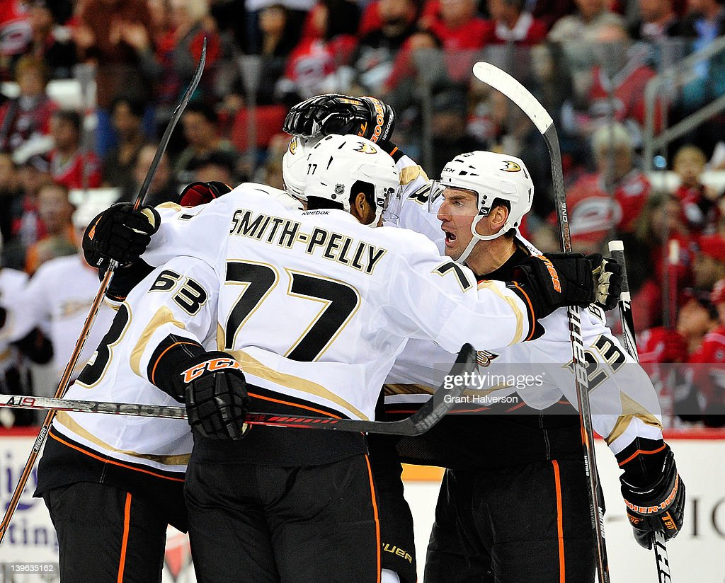 Anaheim Ducks players celebrate a goal by teammate Luca Sbisa #5 during the first period against the Carolina Hurricanes at the RBC Center on February 23, 2012 in Raleigh, North Carolina.