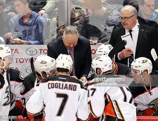 Anaheim Ducks players listen intently as Head Coach Randy Carlyle draws up a play during a third period stoppage against the Winnipeg Jets at the MTS...