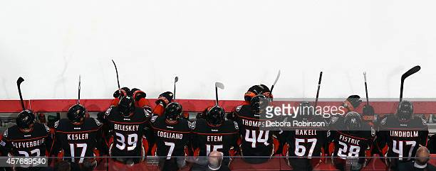 Anaheim Ducks players look on from the bench during the game against the Buffalo Sabres on October 22 2014 at Honda Center in Anaheim California Home...