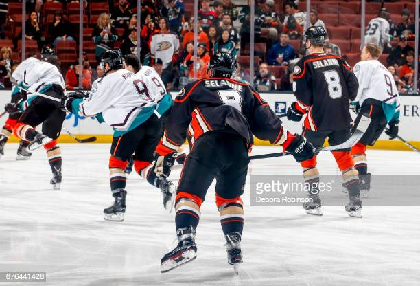 Anaheim Ducks players warm up wearing the jerseys' of former Ducks Teemu Selanne and Paul Kariya for Hall of Fame Night honoring Selanne's and...