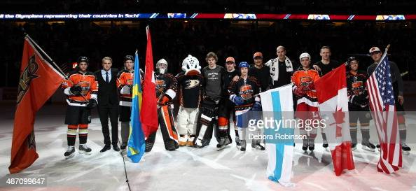 Anaheim Ducks players who are representing their countries' in the upcoming Olympics pose for a photo after the game against Chicago Blackhawks on...