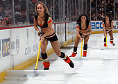 Anaheim Ducks power player girls shovel the ice on February 27 2015 playing against the Los Angeles Kings at Honda Center in Anaheim California