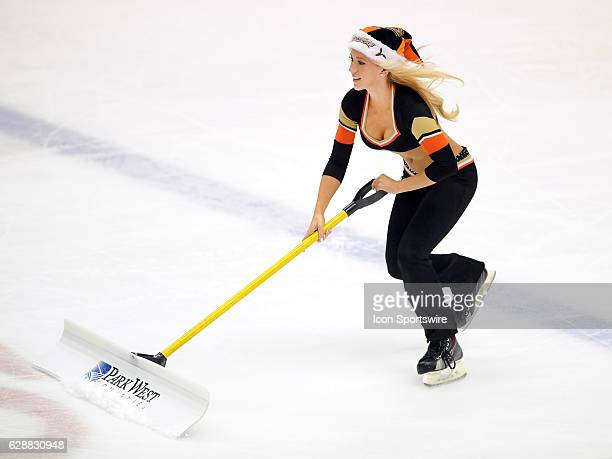 Anaheim Ducks power player in a Santa hat on the ice during a break in the action of the first period of a game against the Carolina Hurricanes on...