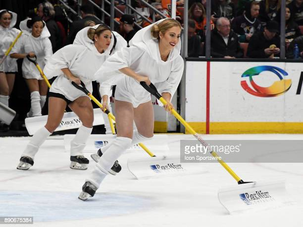 Anaheim Ducks power players on the ice dressed as Princess Leia on Star Wars night during a break in the action of the first period of a game against...