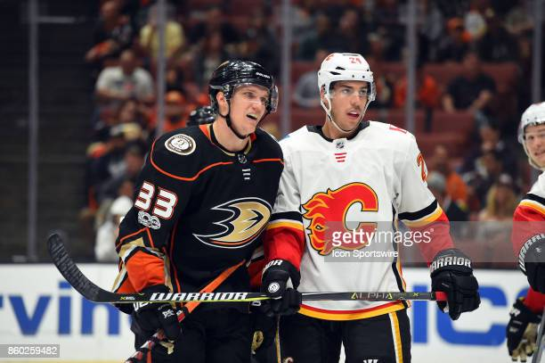 Anaheim Ducks Right Wing Jakob Silfverberg and Calgary Flames Defenseman Travis Hamonic react after a stoppage in play during an NHL game between the...