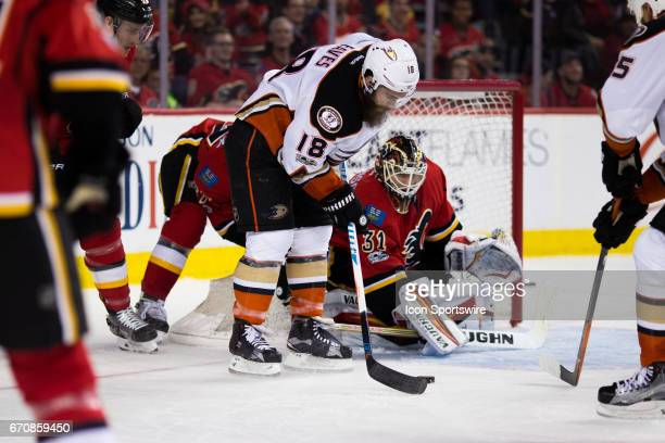 Anaheim Ducks Right Wing Patrick Eaves maneuvers to the front of the Calgary Flames Goalie Chad Johnson puts the paddle down during game 4 of the...