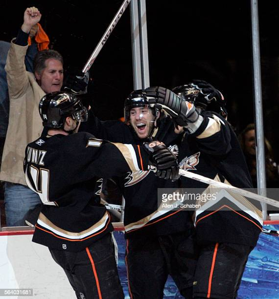 Anaheim Ducks right wing Teemu Selanne right and Chris Kunitz left celebrate Andy McDonald's goal past Vancouver Canucks goaltender Roberto Luongo in...