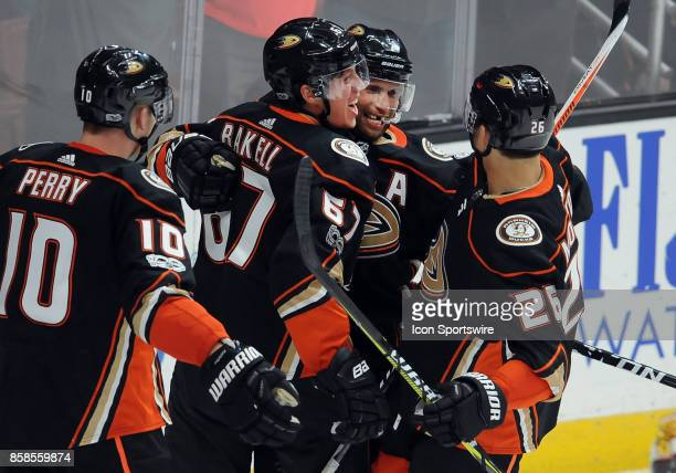 Anaheim Ducks rightwing Andrew Cogliano with center Rickard Rakell after Rakell scored the go ahead goal in the third period of a game against the...