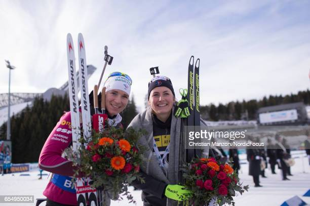 Anais Bescond of France Justine Braisaz of France celebrate after the 10 km men's Sprint on March 17 2017 in Oslo Norway