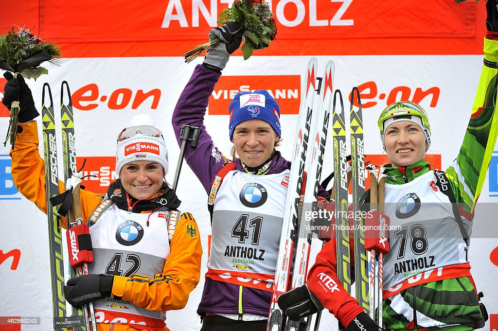 Anais Bescond of France takes 1st place, <a gi-track='captionPersonalityLinkClicked' href=/galleries/search?phrase=Andrea+Henkel&family=editorial&specificpeople=233764 ng-click='$event.stopPropagation()'>Andrea Henkel</a> of Germany takes 2nd place, <a gi-track='captionPersonalityLinkClicked' href=/galleries/search?phrase=Darya+Domracheva&family=editorial&specificpeople=4105955 ng-click='$event.stopPropagation()'>Darya Domracheva</a> of Belarus takes 3rd place during the IBU Biathlon World Cup Women's Sprint on January 16, 2014 in Antholz-Anterselva, Italy.
