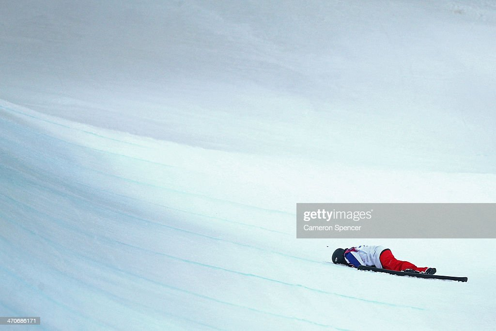 Anais Caradeux of France lies on the snow in the Freestyle Skiing Ladies' Ski Halfpipe Qualification on day thirteen of the 2014 Winter Olympics at Rosa Khutor Extreme Park on February 20, 2014 in Sochi, Russia.