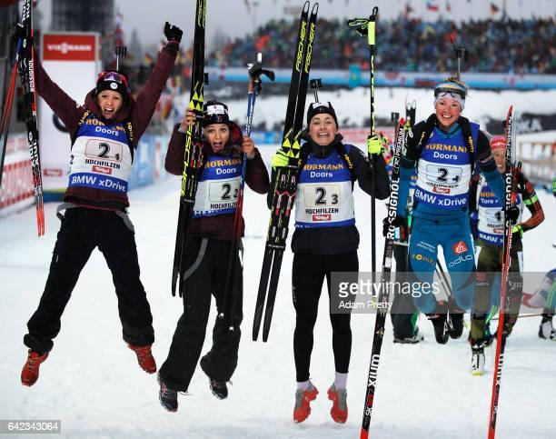 Anais Chevalier Celia Aymonier Justine Braisaz and Marie Dorin Habert of France celebrate winning the Bronze medal in the Women's 4x 6km relay...
