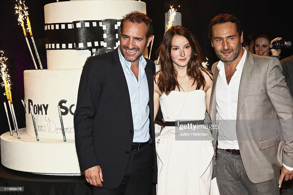 Anais Demoustier and Gilles Lellouche are pictured with Jean Dujardin after being awarded during the Romy Schneider and Patrick Dewaere Awards...