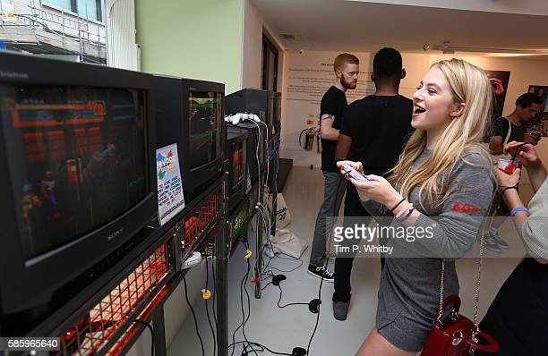 Anais Gallagher playing retro video games at the Reebok Classic 90's Collection Event on August 4 2016 at Rook and Raven Gallery in London England...