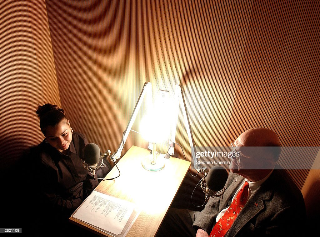 Anaisha Rivera (L) interviews Art Smith (R) in the StoryCorps sound booth December 18, 2003 at Grand Central Station in New York City. Smith, 89, who was abandoned in Gimbles dept. store in 1918 and was placed in foster care by the Children's Aid Society and Rivera, who is also a foster child, interviewed him in an interview arranged by the aid society. StoryCorps is an oral history project that enables people to interview imortant people in their lives and receive a CD recording. The interview is then placed in the collection of the American Folklife Center at the Library of Congress.