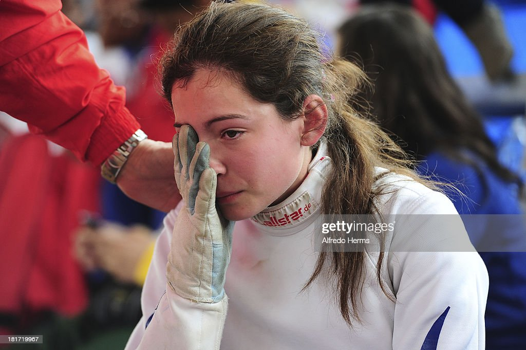 Analia Fernandez of Chile cries after winning the golf medal during the women«s individual Epee competition as part of the I ODESUR South American Youth Games at Gimnasio Villa Deportiva del Callao on September 22, 2013 in Lima, Peru.