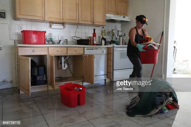 Analis Flores cleans up what she can in her home after it was damaged by hurricane Irma on September 19 2017 in Marathon Florida The process of...