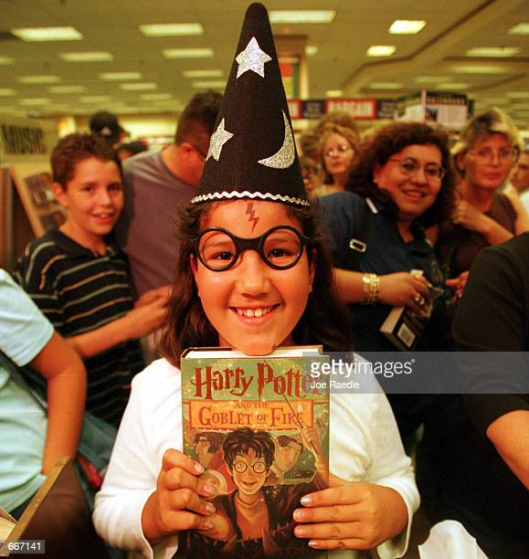 Analise Minjarez gets a copy of the new 'Harry Potter and the Goblet of Fire' book July 8 in the Barnes Noble bookstore in El Paso Texas The store...