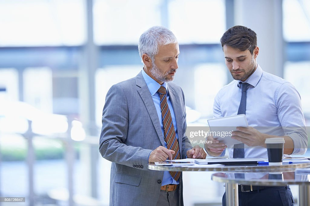 Analysing the day's reports : Stock Photo