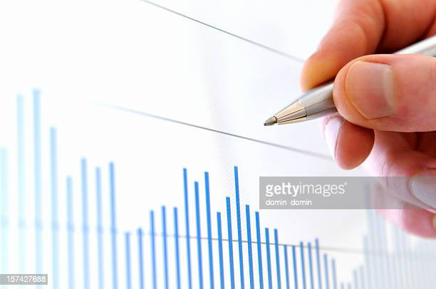 Analysis situation on stock exchange, hand pointing value on screen