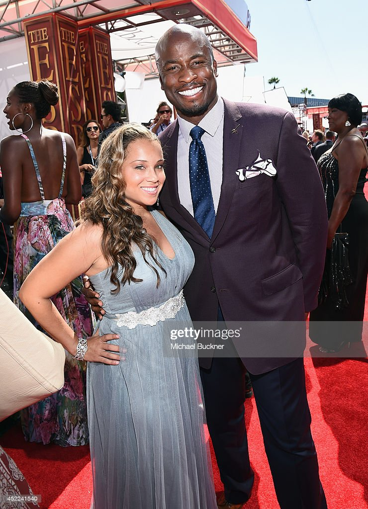 NFL analyst Akbar Gbaja-Biamila with wife Eileen Gbaja-Biamila, attends The 2014 ESPYS at Nokia Theatre L.A. Live on July 16, 2014 in Los Angeles, California.