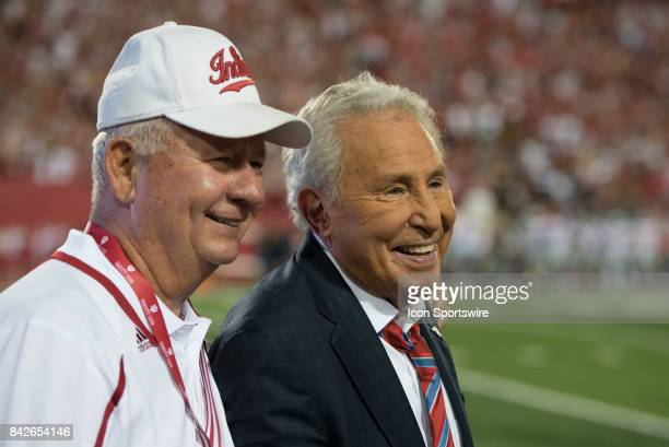 ESPN analyst and former Indiana football coach Lee Corso taking a photo with a fan during a college football game between the Ohio State Buckeyes and...