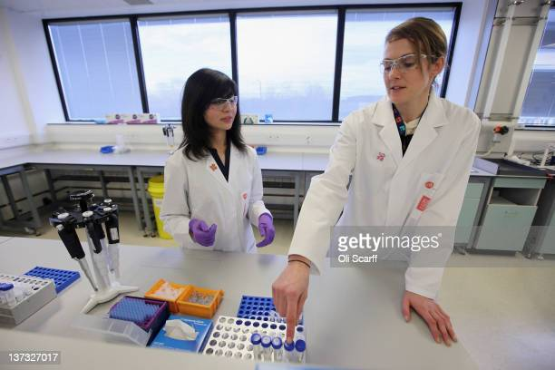 Analyst Arian Nemani explains to Kelly Sotherton a British heptathlete how urine samples are split in the antidoping laboratory which will test...