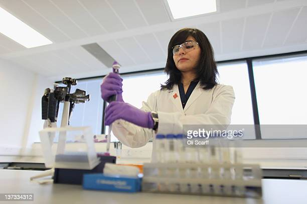 Analyst Arian Nemani splits urine samples in the antidoping laboratory which will test athlete's samples from the London 2012 Games on January 19...
