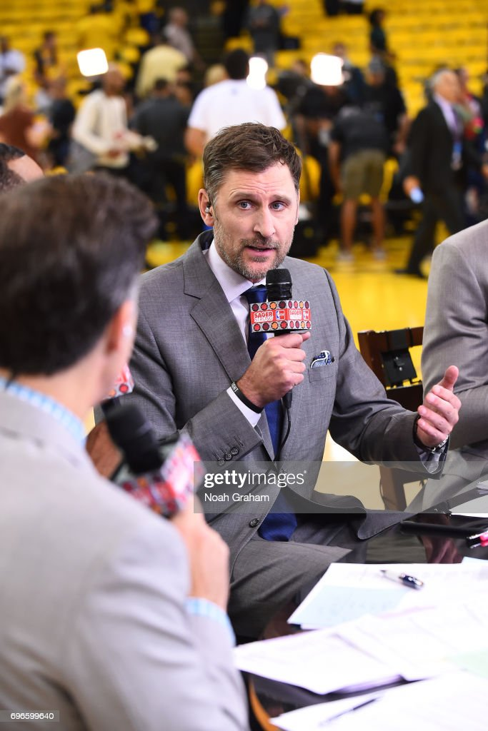 Analyst, Brent Barry talks on set before Game Five of the 2017 NBA Finals between the Cleveland Cavaliers and the Golden State Warriors on June 12, 2017 at Oracle Arena in Oakland, California.
