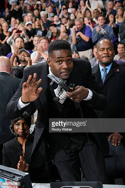 NBA analyst Chris Webber waves to the camera during the game between the Chicago Bulls and Sacramento Kings on November 20 2014 at Sleep Train Arena...