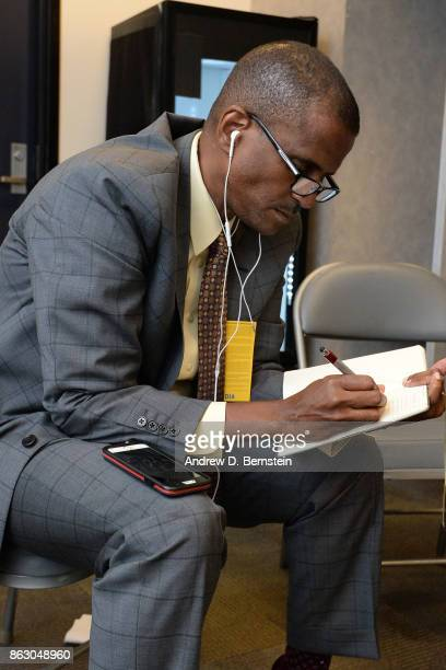 Analyst David Aldridge takes notes before the Houston Rockets game against the Golden State Warriors on October 17 2017 at ORACLE Arena in Oakland...
