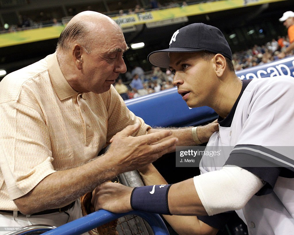 Analyst <a gi-track='captionPersonalityLinkClicked' href=/galleries/search?phrase=Dick+Vitale&family=editorial&specificpeople=730924 ng-click='$event.stopPropagation()'>Dick Vitale</a> gives New York Yankee Alex Rodriguez some advice prior to Monday Night's game against the Tampa Bay Devil Rays at Tropicana Field in St. Petersburg, Florida on May 2, 2005.