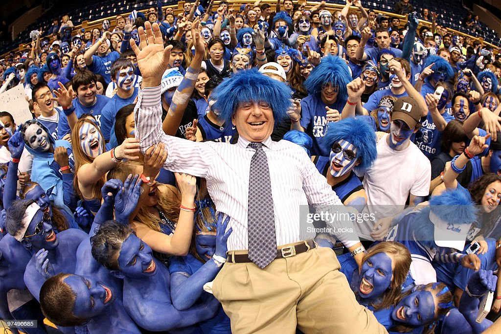 ESPN analyst <a gi-track='captionPersonalityLinkClicked' href=/galleries/search?phrase=Dick+Vitale&family=editorial&specificpeople=730924 ng-click='$event.stopPropagation()'>Dick Vitale</a> surfs the crowd with the Cameron Crazies before the start of the game between the North Carolina Tar Heels and Duke Blue Devils at Cameron Indoor Stadium on March 6, 2010 in Durham, North Carolina.