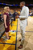 Analyst Doris Burke talks to former NBA player Grant Hill before Game Five of the 2016 NBA Finals between the Cleveland Cavaliers and the Golden...