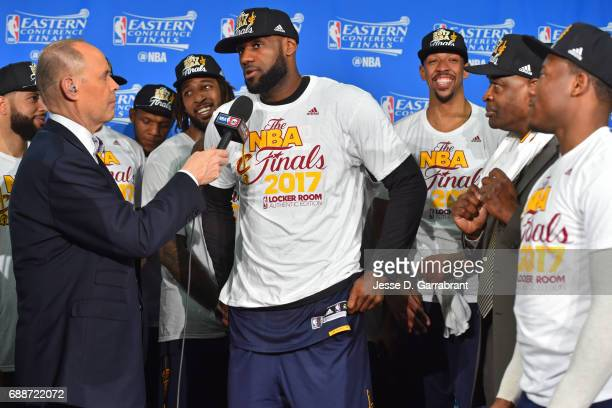 Analyst Ernie Johnson interviews LeBron James of the Cleveland Cavaliers during the photo shoot after winning Game Five of the Eastern Conference...