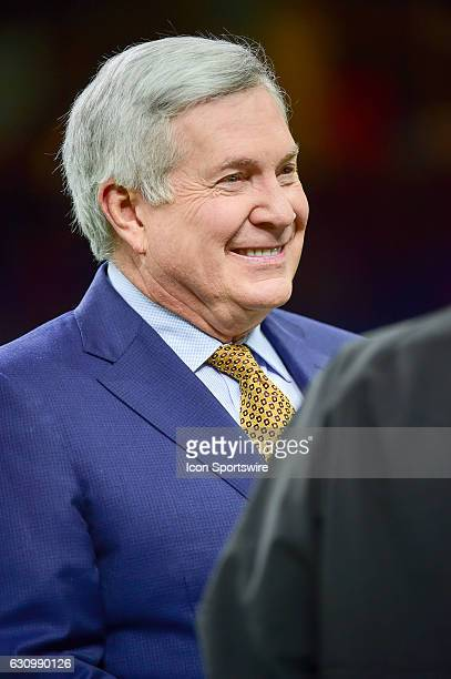 ESPN analyst Mack Brown talks with friends before the Sugar Bowl game between the Auburn Tigers and Oklahoma Sooners on January 2 at the MercedesBenz...