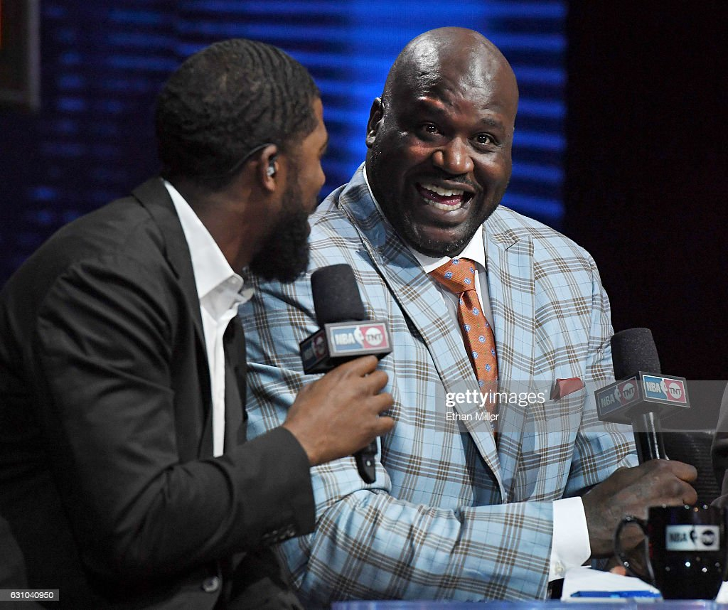 NBA analyst Shaquille O'Neal (R) laughs as he interviews center fielder Dexter Fowler of the St. Louis Cardinals during a live telecast of 'NBA on TNT' at CES 2017 at the Sands Expo and Convention Center on January 5, 2017 in Las Vegas, Nevada. CES, the world's largest annual consumer technology trade show, runs through January 8 and features 3,800 exhibitors showing off their latest products and services to more than 165,000 attendees.