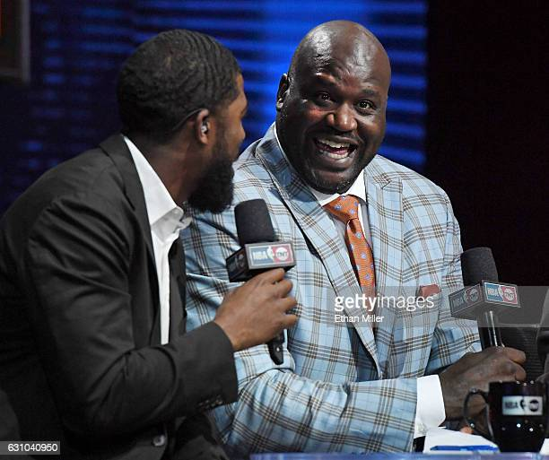 NBA analyst Shaquille O'Neal laughs as he interviews center fielder Dexter Fowler of the St Louis Cardinals during a live telecast of 'NBA on TNT' at...