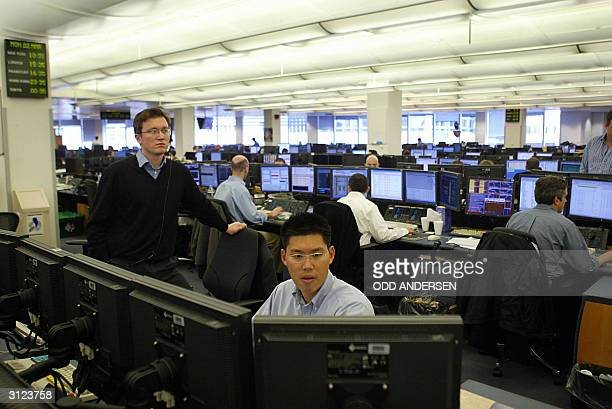 Analysts work on the trading floor at Goldman Sachs in London 22 March 2004 AFP PHOTO / ODD ANDERSEN