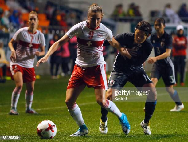 AnaMaria Crnogorcevic of Switzerland controls the ball under pressure of Mizuho Sakaguchi of Japan during the international friendly match between...